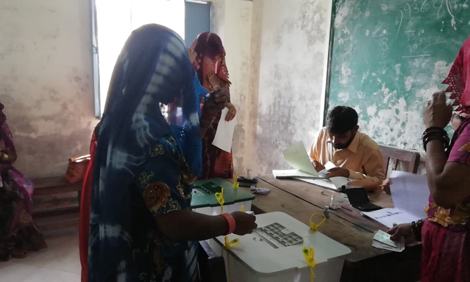 A Thari woman casts her ballot. —Photo provided by author