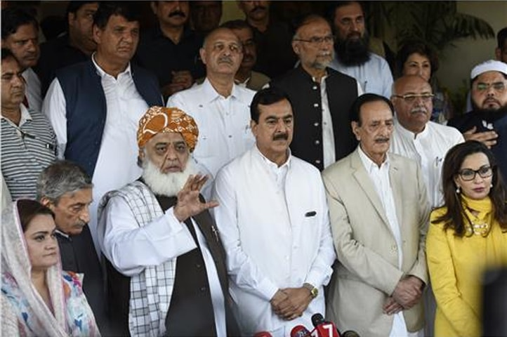 ISLAMABAD: Jamiat Ulema-i-Islam-Fazl chief Maulana Fazlur Rehman talks to media personnel after his meeting with leaders of Pakistan Peoples Party, Pakistan Muslim League-Nawaz and other parties on Monday.­—Online