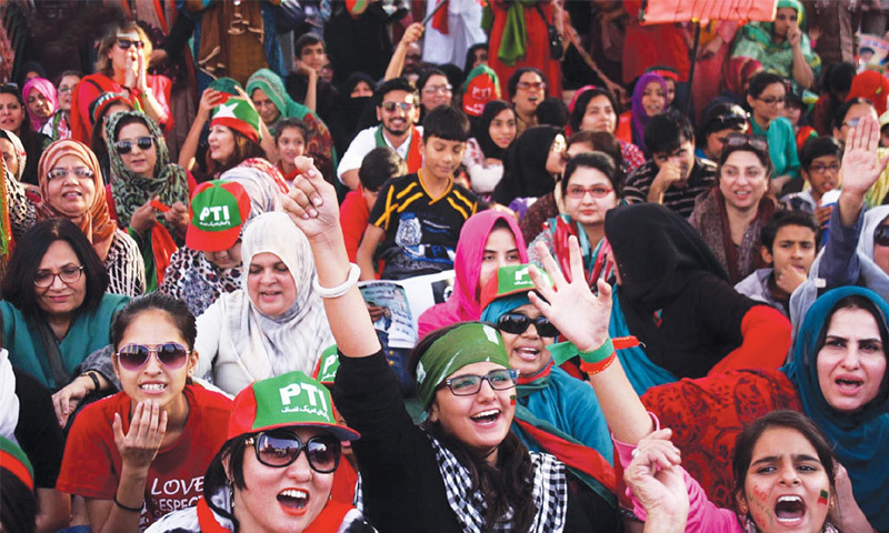 Supporters of the PTI chant slogans during a sit-in demonstration at the Teen Talwar roundabout in Clifton in 2014.—Online