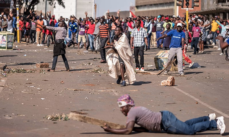 Supporters of Zimbabwe's MDC party demonstrate outside ZANU PF headquarters in Harare on Wednesday, as protests erupted over alleged fraud in the country's election. — AFP