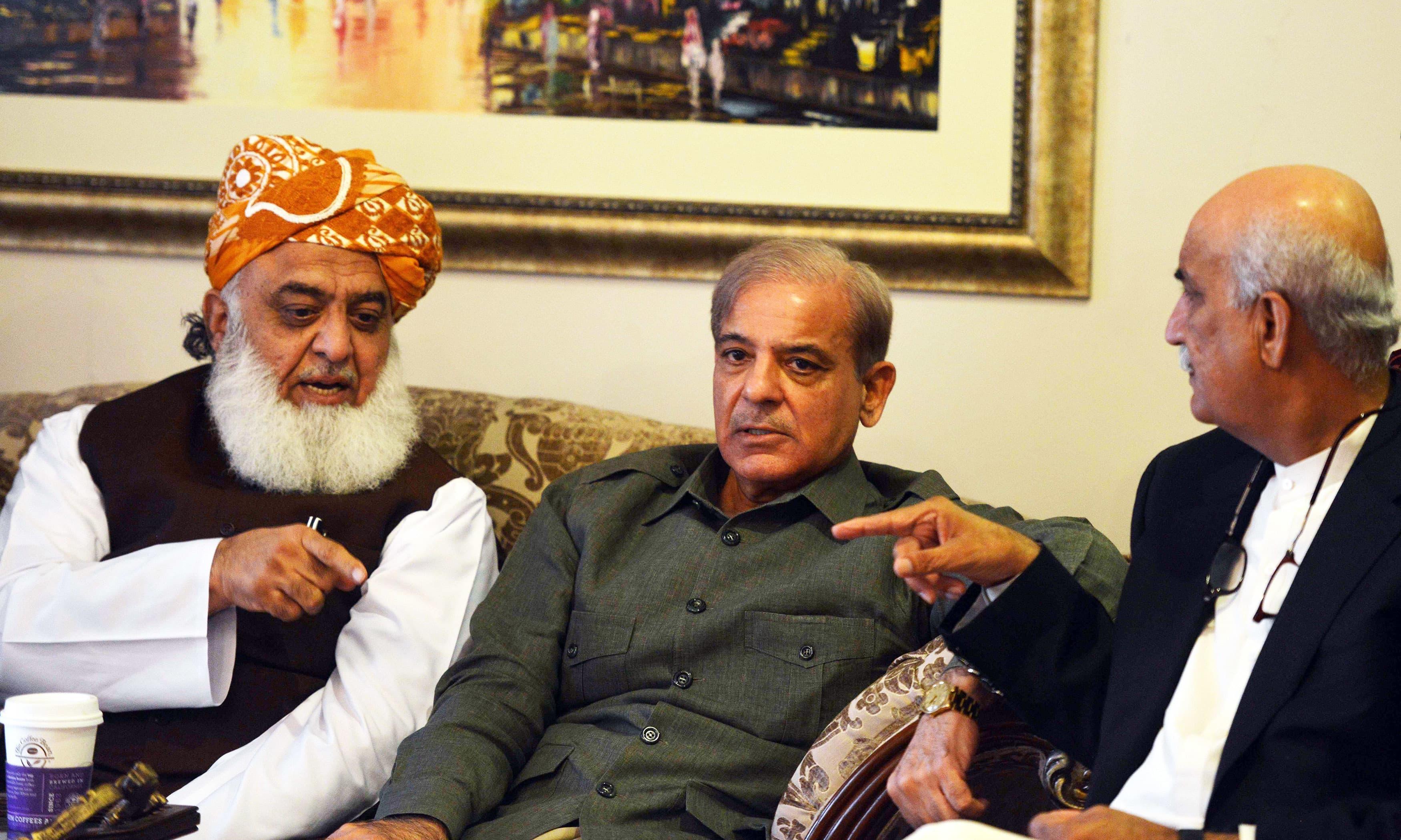 Shahbaz Sharif speaks with Fazalur Rehman and Khursheed Shah. —AFP