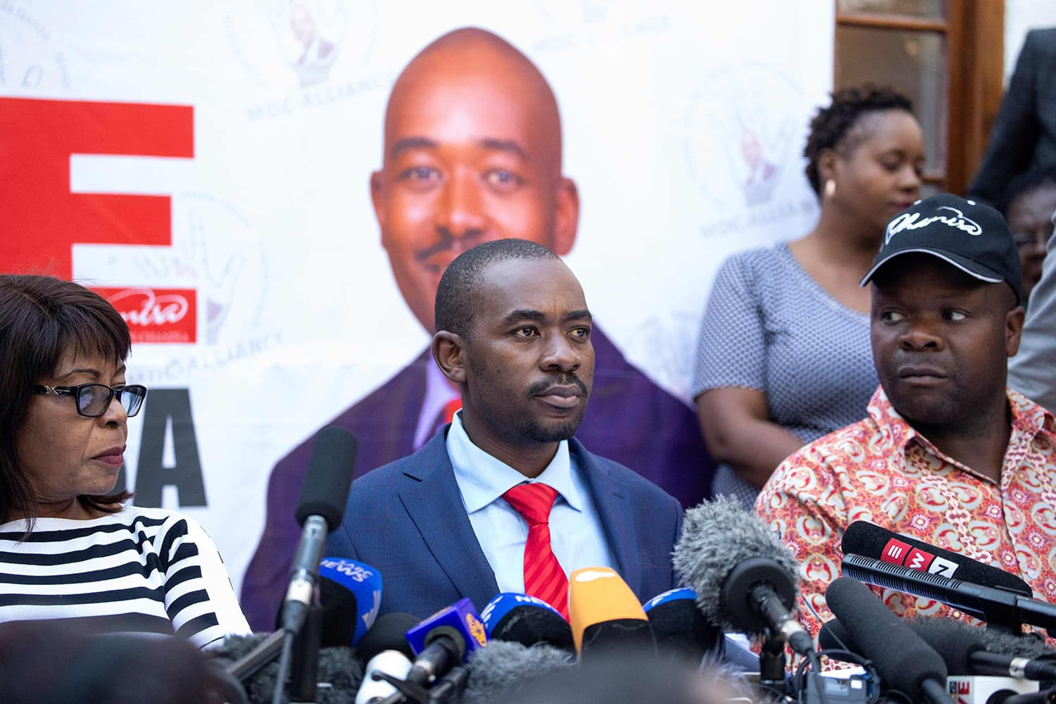 Zimbabwe's MDC leader Nelson Chamisa (C) addresses a press conference at The Bronte Hotel in Harare on August 3, 2018. —AFP