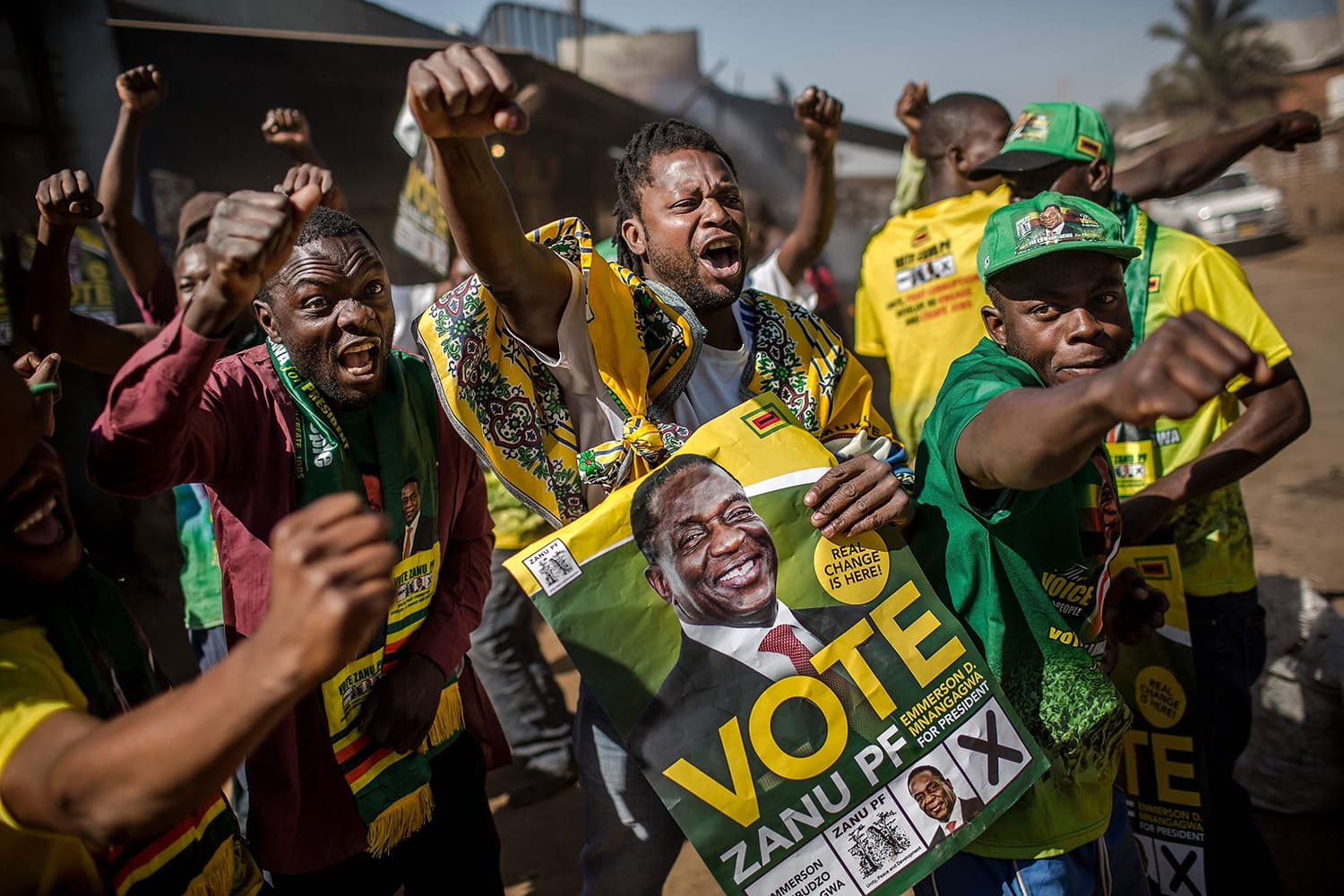 Supporters celebrate after Emmerson Mnangagwa has been declared the winner in the country's landmark election. —AFP