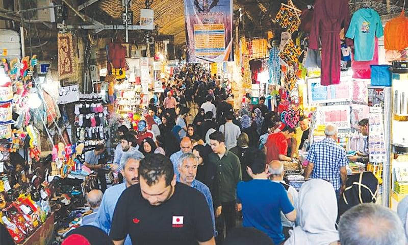PEOPLE walk inside Tehran's ancient Grand Bazaar.—AFP