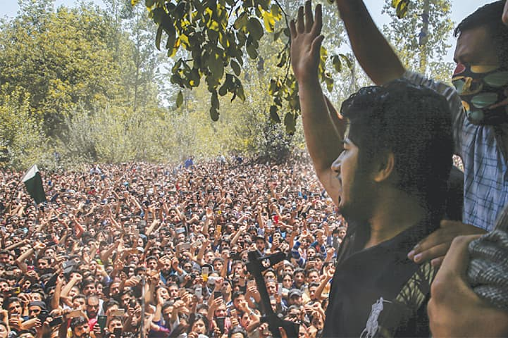 VILLAGERS shout slogans as a commander arrives to pay tribute to slain Kashmiri fighters in Malikgund village of India-held Kashmir on Saturday.—AP