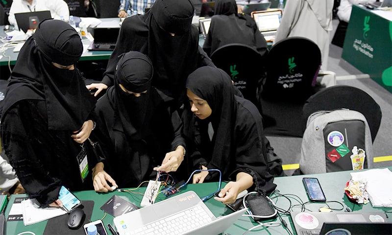 Saudi women attend a hackathon in Jeddah. ─ AFP
