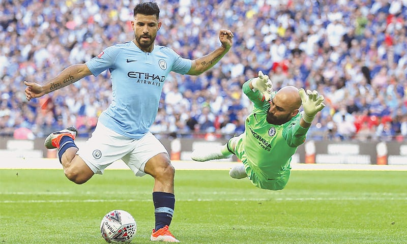 LONDON: Manchester City's Sergio Aguero (L) goes past Chelsea goalkeeper Willy Caballero during their Community Shield match at the Wembley Stadium on Sunday.—AFP