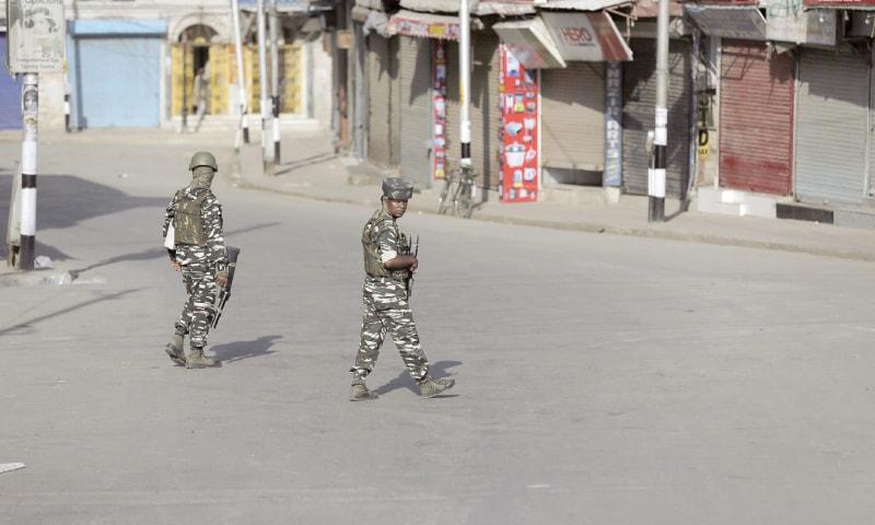 SRINAGAR: Indian soldiers patrol a closed market during a strike on Sunday.—AP