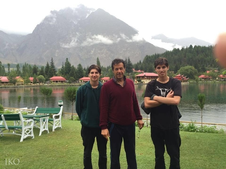 Imran Khan with his sons in Pakistan. They live with their mother in the UK. ─ File