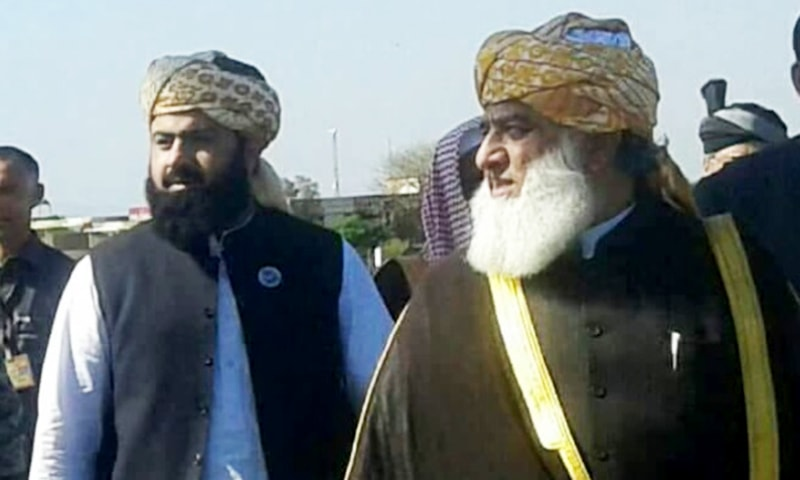 Fazalur Rehman with his son Asad Mehmood. — Photo provided by author