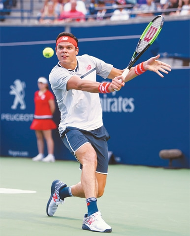 TORONTO: Milos Raonic of Canada hits a return to Belgium's David Goffin during the Rogers Cup match at Aviva Centre.—AFP