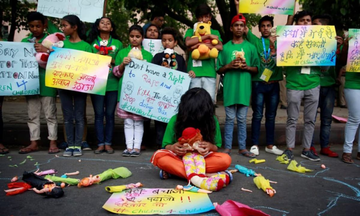 Children take part in a protest against the rape of an eight-year-old girl, in Kathua, near Jammu and a teenager in Unnao, Uttar Pradesh state, in New Delhi | Reuters, Cathal McNaughton