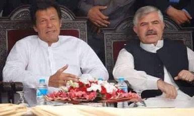 Mahmood Khan with PTi Chairman Imran Khan — Photo courtesy: Twitter