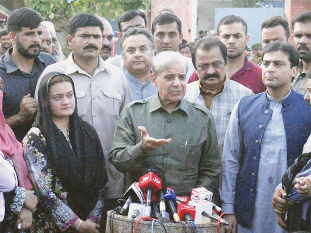PML-N president Shahbaz Sharif talking to reporters after meeting with party supremo Nawaz Sharif at Adiala jail.—Online