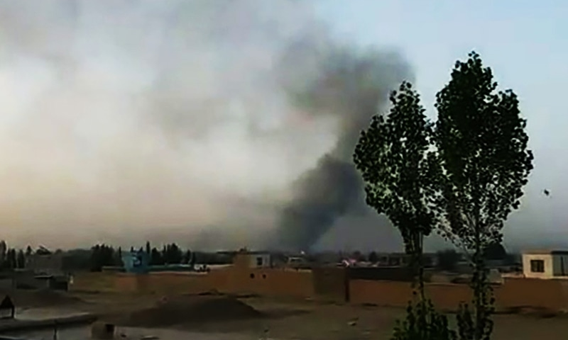 This screen grab taken from AFPTV video shows smoke rising into the air after Taliban militants launched an attack on Ghazni.—AFP