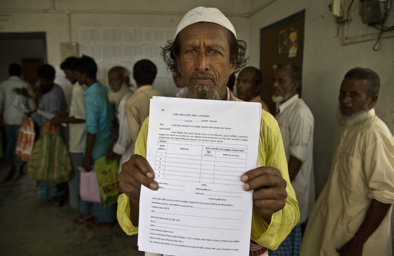 Kismat Ali, whose wife's name did not appear on the National Register of Citizens (NRC) draft, shows a form he collected to file an appeal in Mayong. ─ AP/File