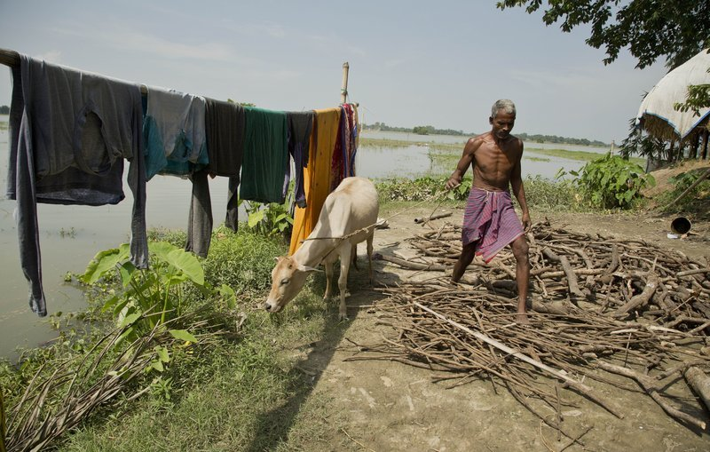 In this Aug 9 photo, Hindu farmer Khitish Namo Das, 50, who insists he was born in India, works at his house in Mayong, 45 kilometers east Gauhati, India. ─ AP