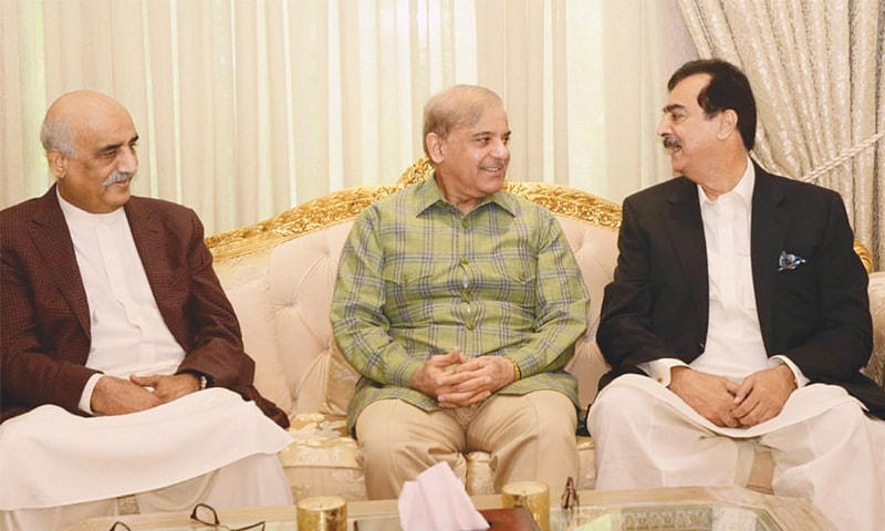LAHORE: Pakistan Peoples Party leaders Yousuf Raza Gilani and Khursheed Shah speak to Pakistan Muslim League-Nawaz president Shahbaz Sharif during a meeting on Saturday.—Online