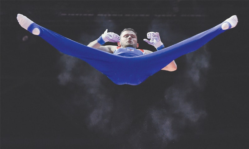 GLASGOW: Britain's Dominick Cunningham competes on the horizontal bar in the men's team final of the artistic gymnastics at the SSE Hydro.—AFP