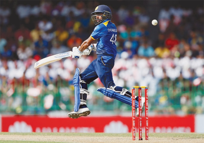 COLOMBO: Sri Lankan opener Niroshan Dickwella plays a shot to be caught out by South African captain Quinton de Kock (not in picture) during the fifth ODI on Sunday.—Reuters