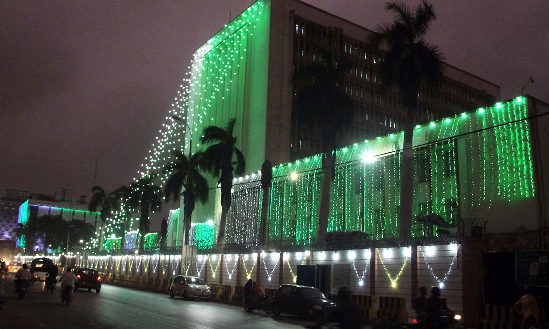 View of an illuminated building on I I Chundrigar road in Karachi on the eve of Independence Day. —Online
