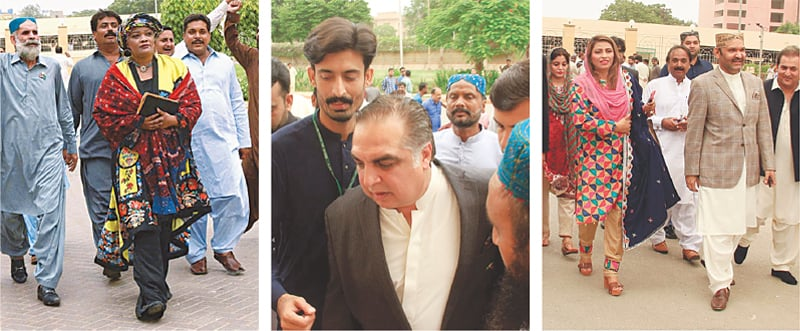 PPP's Tanzeela Qambrani, PTI's governor-designate Imran Ismail and GDA's Nusrat Sehar Abbasi and Ali Gohar Mahar make their way into the assembly building on Monday.—Agencies