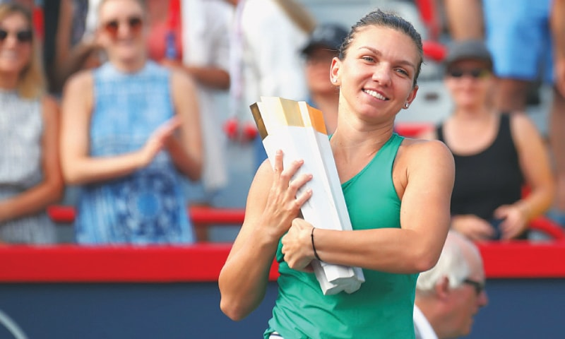 MONTREAL (Quebec): Simona Halep of Romania holds her trophy at Stade IGA. —Reuters