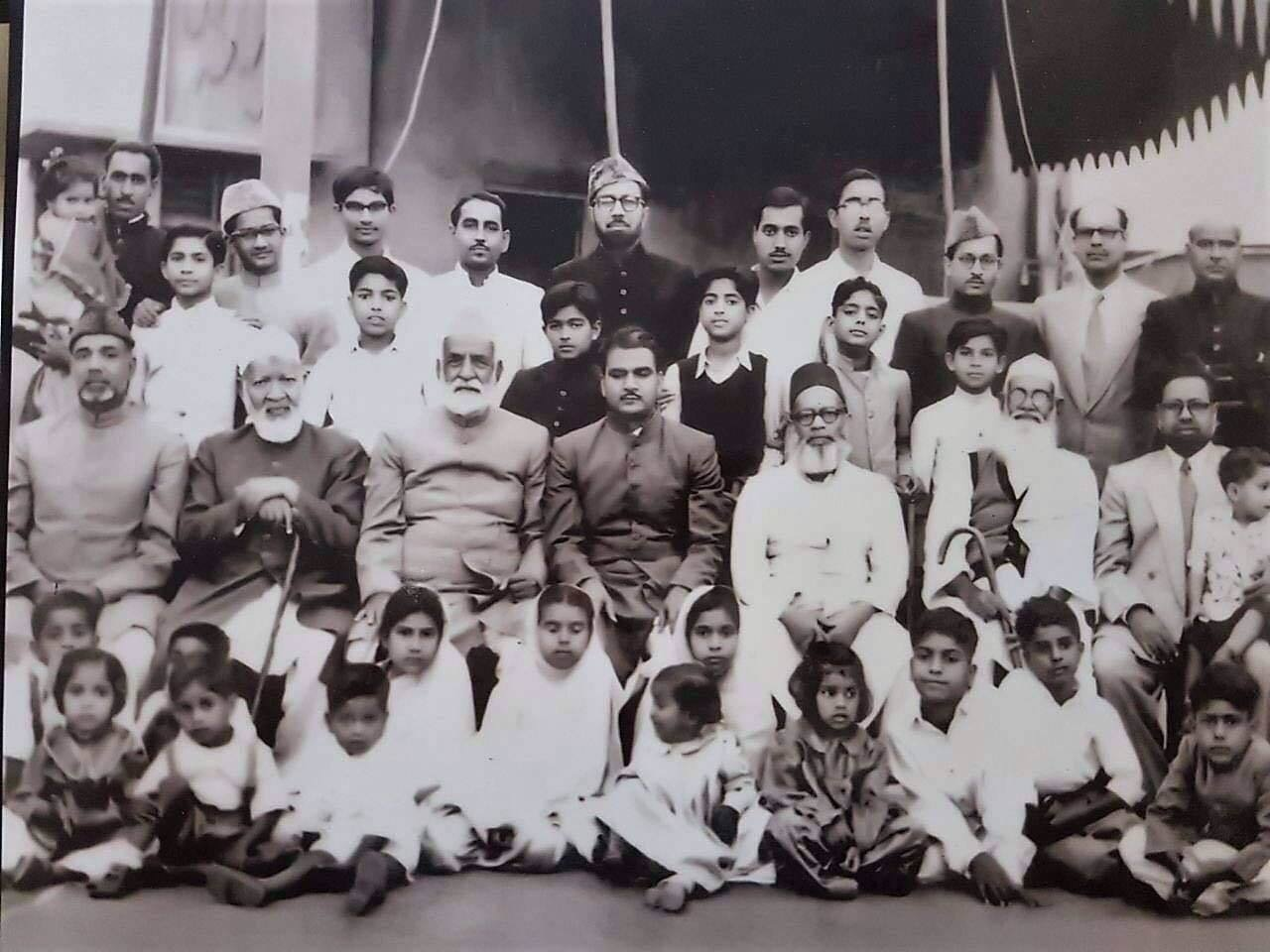 Author's family, with her grandfather fifth from left, third row from top. –Photo by the author
