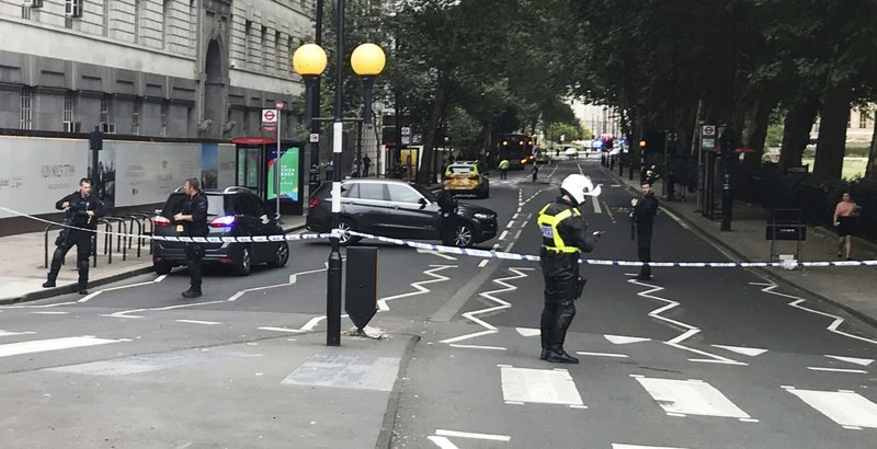 Police patrol on Millbank, in central London, after a car crashed into security barriers outside the Houses of Parliament, in London, on Tuesday. — AP