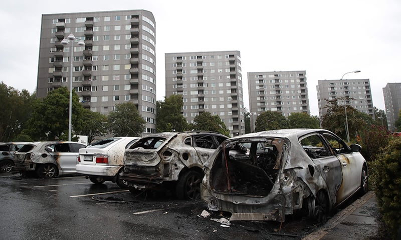 Burned cars are pictured at Froelunda Square in Gothenburg, Sweden. —AFP