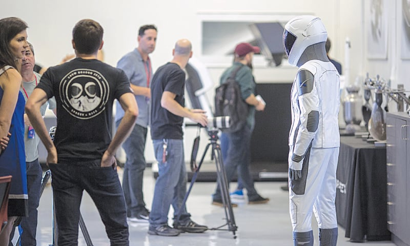 HAWTHORNE (California, US): A spacesuit designed for use on a spacecraft is seen during a media tour of SpaceX headquarters and rocket factory. SpaceX plans to use the spaceship Crew Dragon, a passenger version of the robotic Dragon cargo ship, to carry Nasa astronauts to the International Space Station for the first time since the space shuttle programme was retired in 2011.—AFP