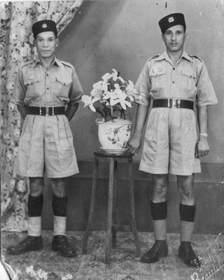 My maternal grandfather, Hayat Shah (right) posing for a photograph in his uniform. He came from a village near the town of Mansehra and served in the Naval Police Force.—Photo by author