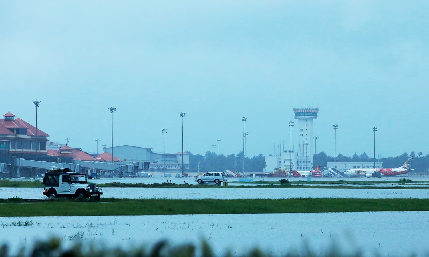 Kochi's International airport apron is seen flooded following monsoon rains in the Indian state of Kerala. —AFP