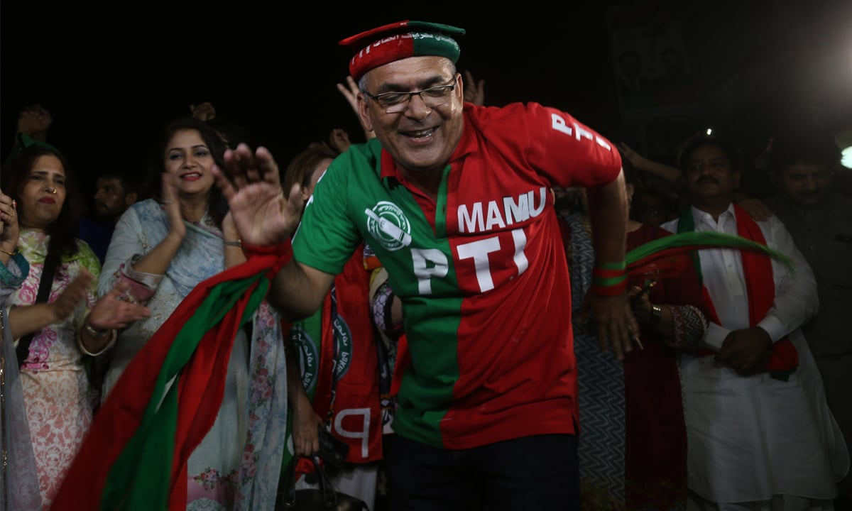 A Pakistan Tehreek-e-Insaf supporter celebrating the election results | White Star