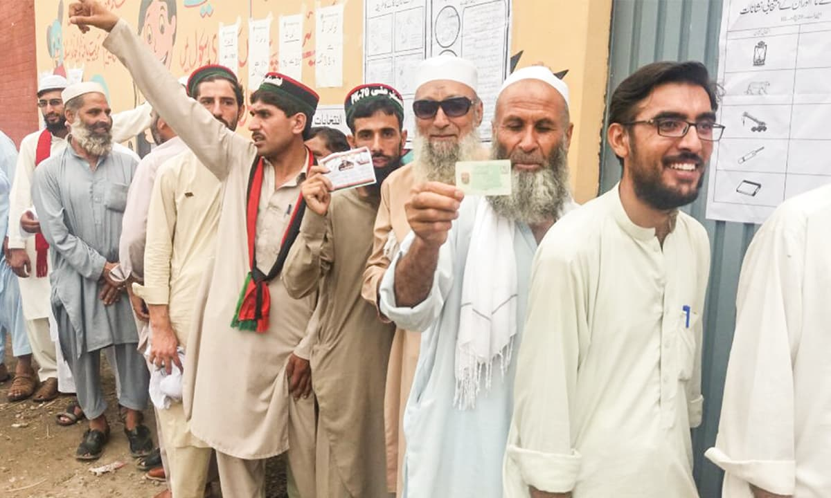 Voters waiting for their turn outside a polling station in Peshawar | Ghulam Dastageer