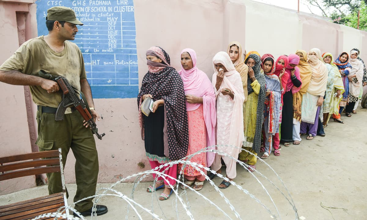 Voters waiting in line outside a polling station in Lahore | Murtaza Ali, White Star