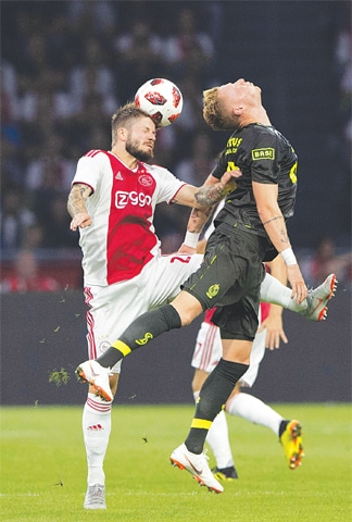 AMSTERDAM: Lasse Schone (L) of Ajax vies for the ball with Standard Liege's Renaud Emond during their match at the Johan Cruijff Arena.—AFP