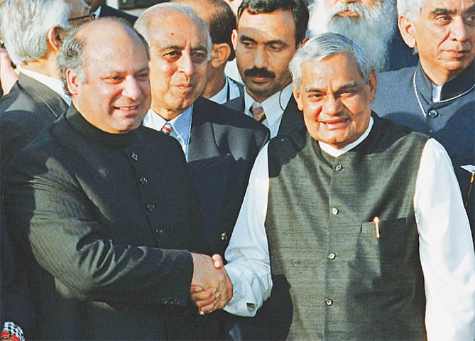 In this photo taken on Feb 20, 1999, then prime minister Nawaz Sharif receives then Indian prime minister Atal Bihari Vajpayee at the Wagah border near Lahore.—AP