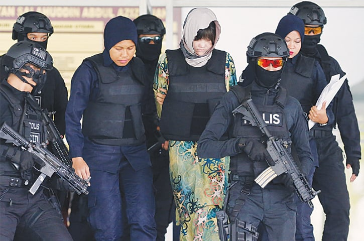 Kuala Lumpur: Police escort Doan Thi Huong of Vietnam, who is on trial for the killing of Kim Jong Nam, the estranged half-brother of North Korea's leader Kim Jong Un, out of the Shah Alam High Court.—Reuters