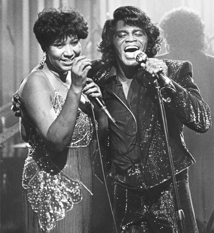 Aretha Franklin with soul singer James Brown during the taping of a show in Detroit on Jan 11, 1987.—AP