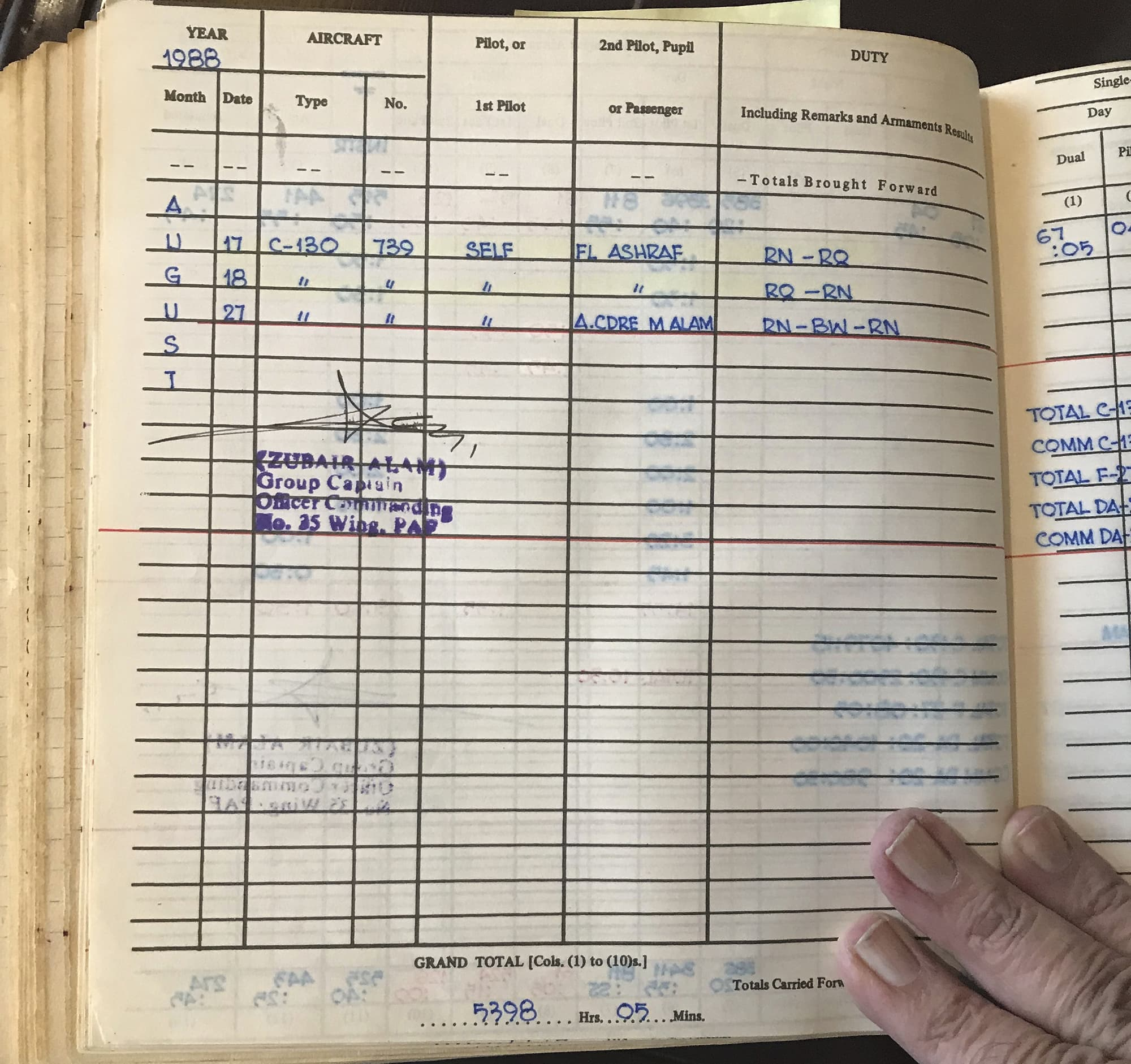 Wing Commander Munawar Alam shows the logbook entry for his back-up C-130 flight on Aug 17, 1988. — White Star