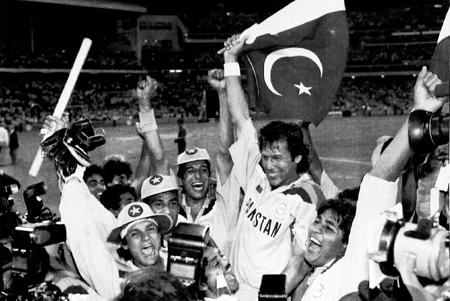 In this March 25, 1992 file photo, Imran Khan waves a Pakistan flag and is chaired by his team mates after Pakistan defeats England in the World Cup Cricket Final in Melbourne, Australia. ─ AP