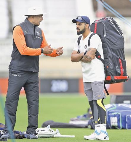 NOTTINGHAM: India's head coach Ravi Shastri speaks with skipper Virat Kohli during a net practice session at Trent Bridge on Friday.—AP