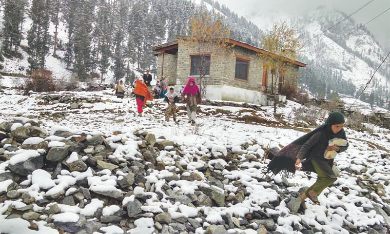 Despite the weather, children eagerly walk to the school