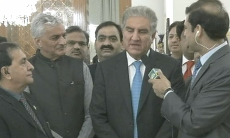 PTI vice-president Shah Mehmood Qureshi speaks to a reporter after arriving for Imran Khan's oath-taking. — DawnNewsTV