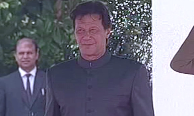 Imran Khan inspects a guard of honour at PM House. — DawnNewsTV