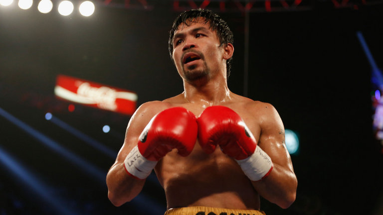 Manny Pacquiao has won an unparalleled 12 world titles in eight different weight divisions. ─ AFP