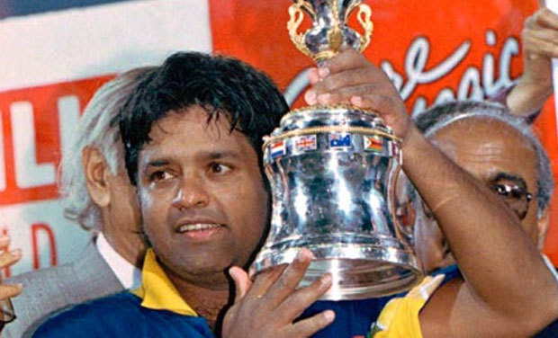 The then Sri Lanka captain poses with the 1996 World Cup trophy. ─ AP