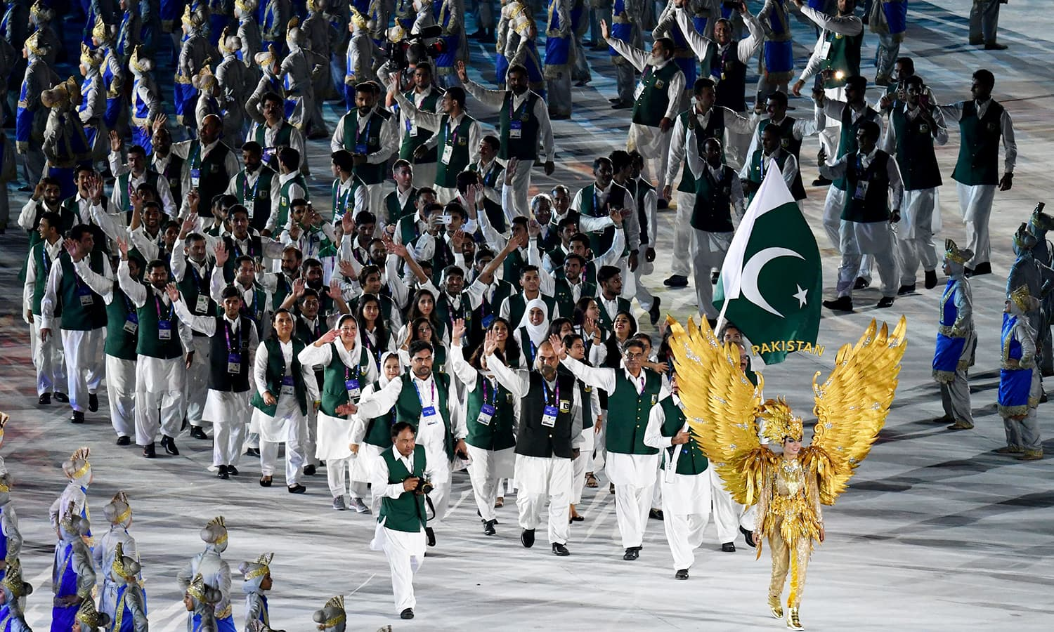 Pakistan's delegation parades during the opening ceremony of the 2018 Asian Games. —AFP