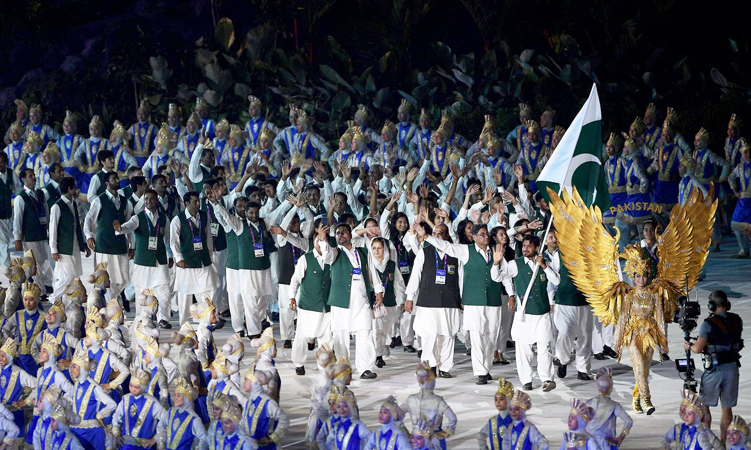 Pakistan's delegation waves to a packed crowd during the opening ceremony of the 2018 Asian Games. —AFP